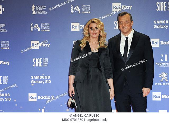 Italian director Gabriele Muccino with his wife Angelica Russo during the red carpet of the 64th edition of the David di Donatello