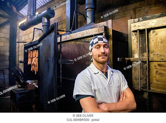 Portrait of smoker in smokehouse