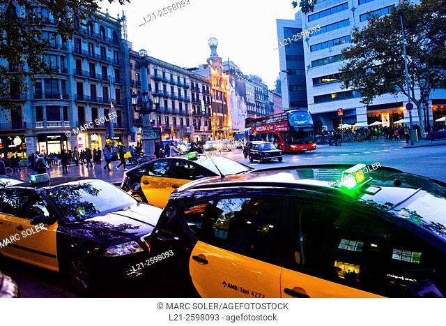 Taxis, taxi station at dusk. Cityscape, panorama. Carrer Pelai, La Rambla, Plaça de Catalunya. Barcelona, Catalonia, Spain