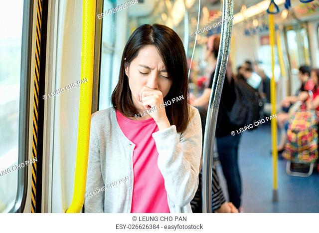 Woman feeling unwell inside train