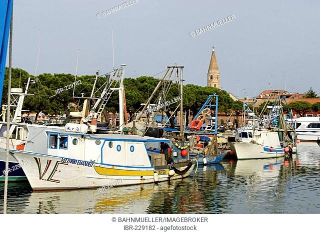 Caorle at the Adria region Veneto Italy at the fishing harbour with the church