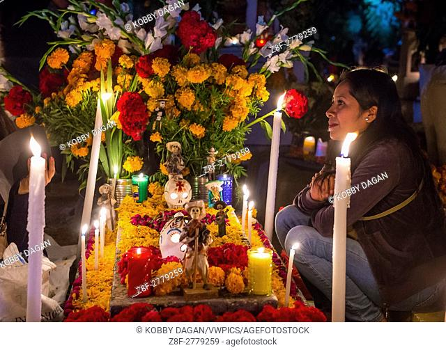 Mexican woman in a cemetery during Day of the Dead in Oaxaca, Mexico