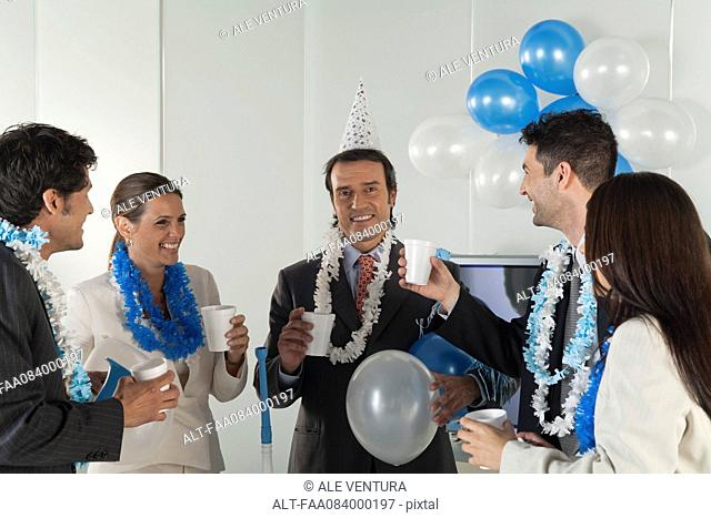 Office celebration, business people making a toast