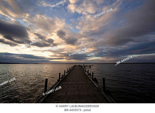 Jetty on Lake Steinhude, cloudy sky in the evening light, Lower Saxony, Germany