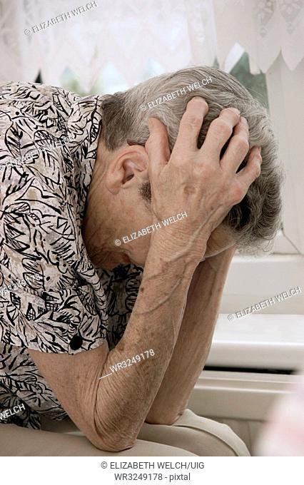 Vulnerable elderly woman feeling worried