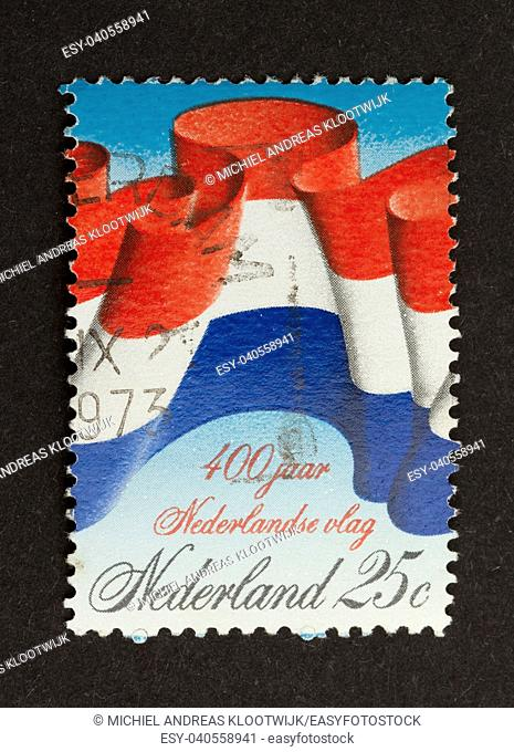 HOLLAND - CIRCA 1970: Stamp printed in the Netherlands shows the national flag, circa 1970
