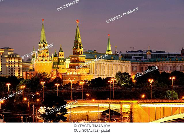 View of Kremlin towers and the Bolshoy Kamenny bridge at night, Moscow, Russia