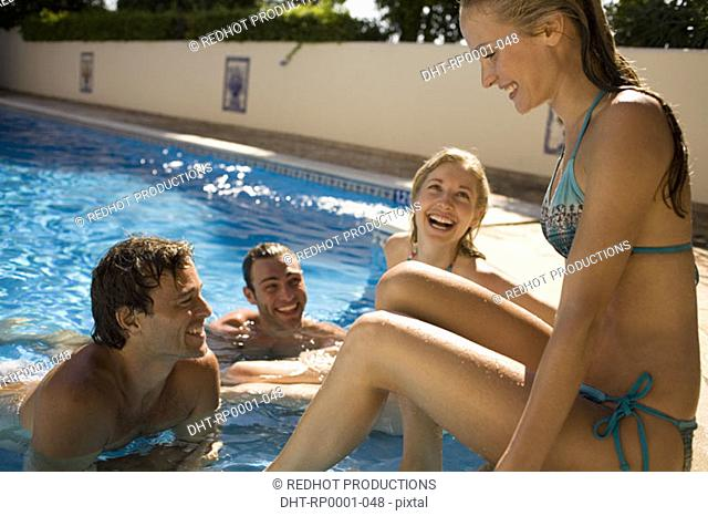 Young couples by pool