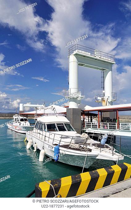 Okinawa, Japan, pier at Azama Sunsun Beach with the boats for Kudaka Island