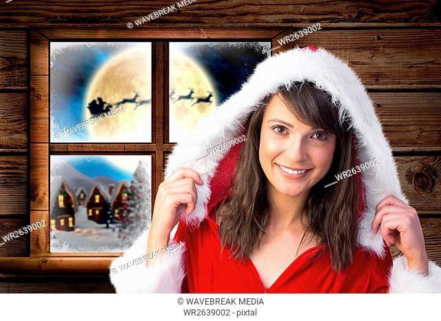 Woman in santa costume smiling at camera