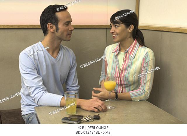 young couple having a conversation in restaurant