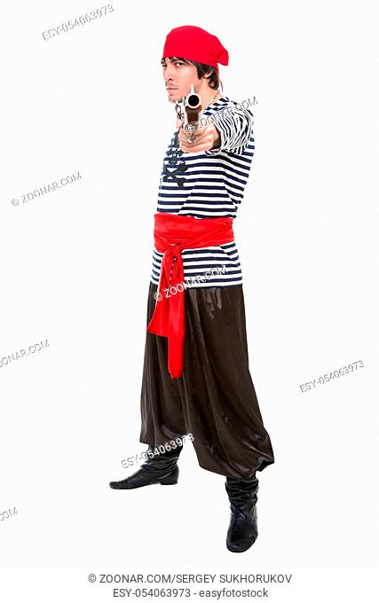 Attractive aiming pirate posing in the studio. Isolated on white
