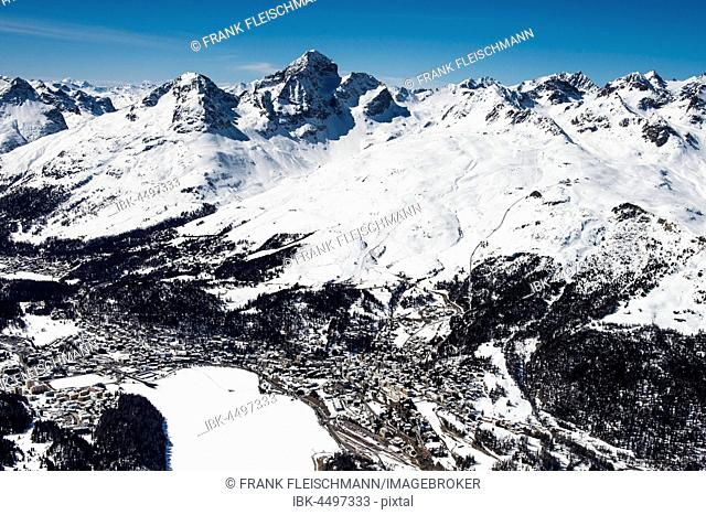 St.Moritz with St.Moritzsee in the winter mountains Piz Nair, Piz Corviglia, Engadin, Canton of Grisons, Switzerland