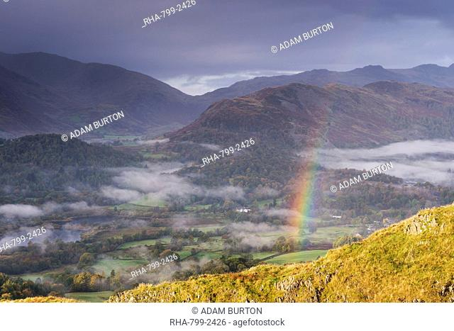 Rainbow over mist shrouded autumn landscape, Elterwater, Lake District, Cumbria, England, United Kingdom, Europe
