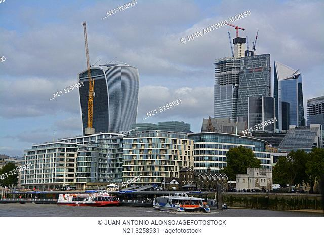 The 20 Fenchchurch Street Building, nicknamed the Walkie Talkie behind an apartment building complex. On the right we see the 22 Bishopgate Building under...