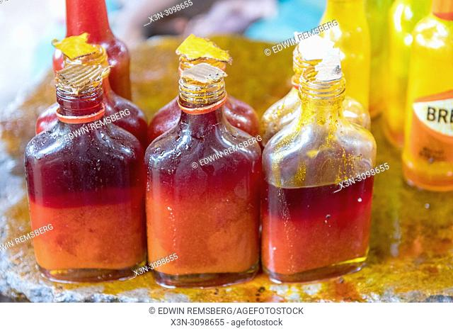 Bottles are full of red African Palm Oil (Elaeis guineensis) Ganta, Liberia