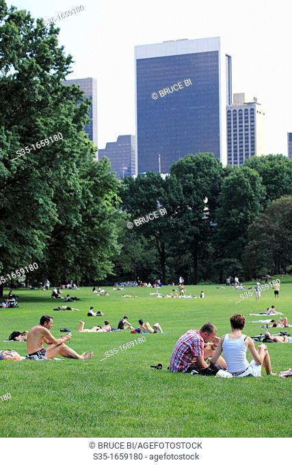 Visitors relax on the Great Lawn of Central Park  Manhattan  New York City  USA