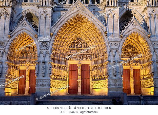 Night view  Ornate doorway of the Cathedral of Notre Dame, from XIII Century, in Amiens listed as World Heritage by UNESCO  It's the Highest ghotic cathedral of...