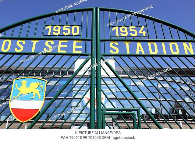 17 June 2019, Mecklenburg-Western Pomerania, Rostock: The old gate of the former stadium stands on the parking lot in front of the Ostseestadion