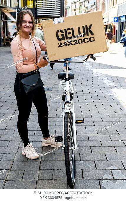 Tilburg, Netherlands. During the CapeTown karton boxes artwork project, all kinds of wishes printed on boxes, were distributed to people passing by