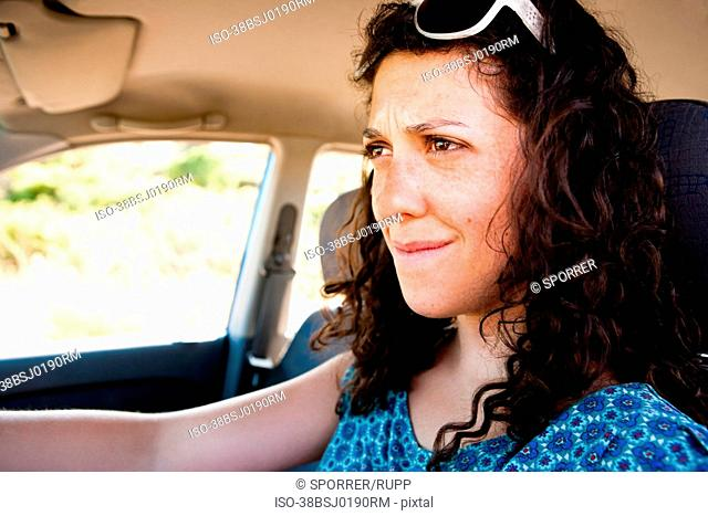 Frustrated woman driving car