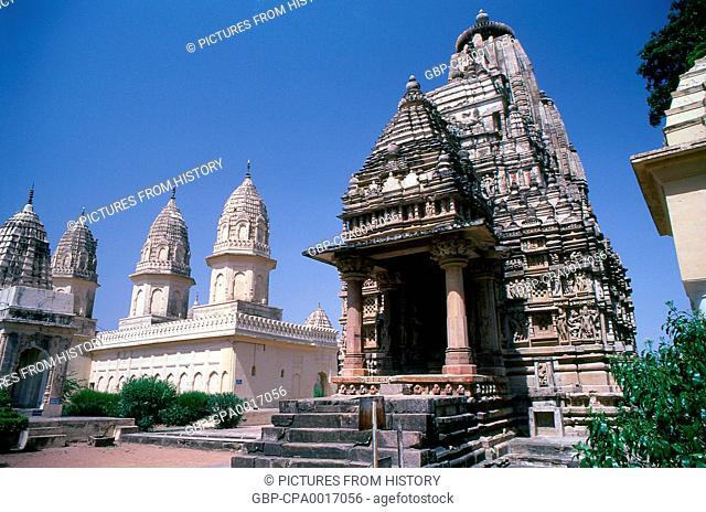 India: Archaic Parsvanath Temple stands close by the newer Santinatha Temple, Khajuraho, Madhya Pradesh State