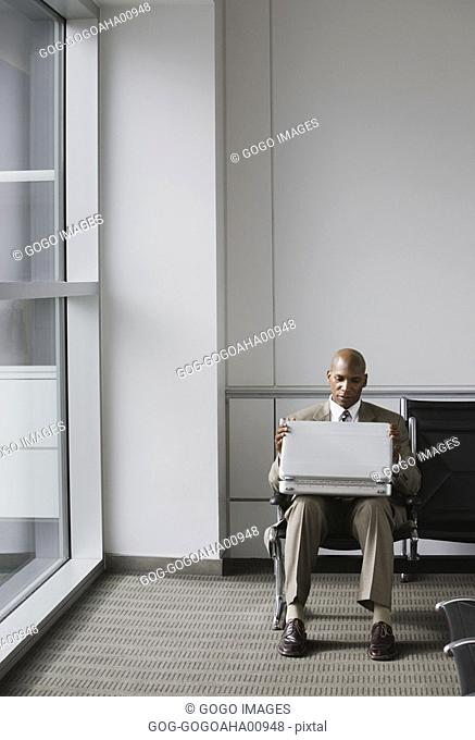 African businessman in waiting area