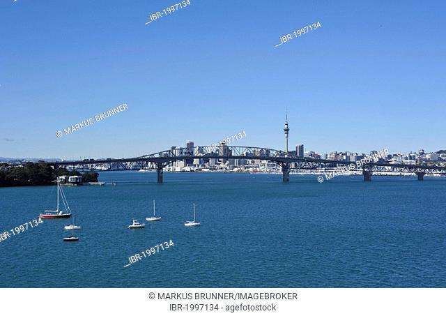 View from Birkenhead on Harbour Bridge and skyline with Skytower, Auckland, New Zealand