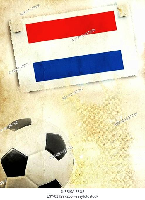Photo of Netherland flag and soccer ball