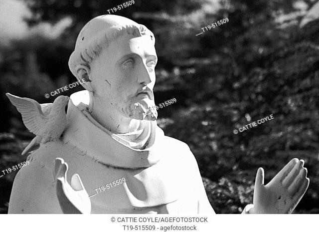Statue of St. Francis in St. Leonard's Peace Garden, North End, Boston, MA. St. Leonard's Church, founded in 1873, is the first Roman Catholic Church in New...
