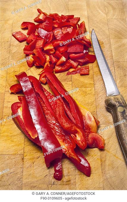 Cutting red bell peppers, Salobreña, Granada, Spain