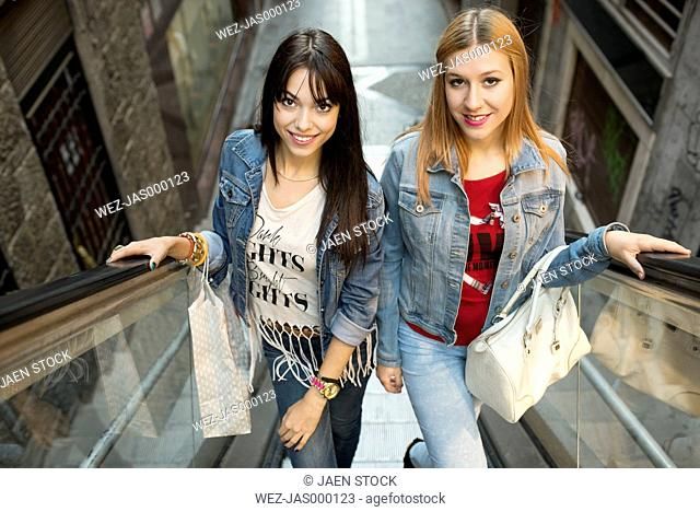 Spain, Jaen, two young women on shopping tour