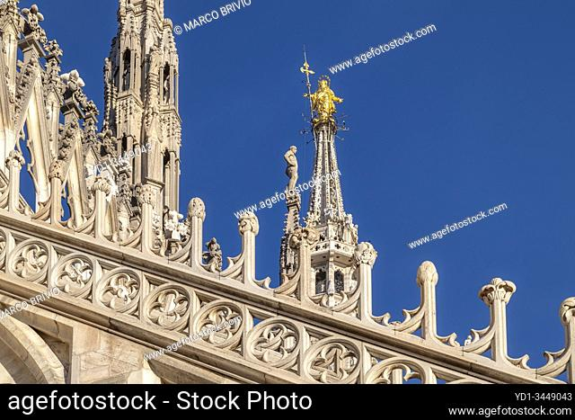 Milan Italy. The gold Madonna at the top of the Duomo cathedral