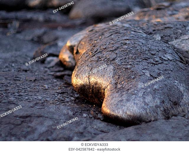 This freshly hardened and still hot lava has splintered and formed just to the side of the active flow of Kilauea on the Big Island