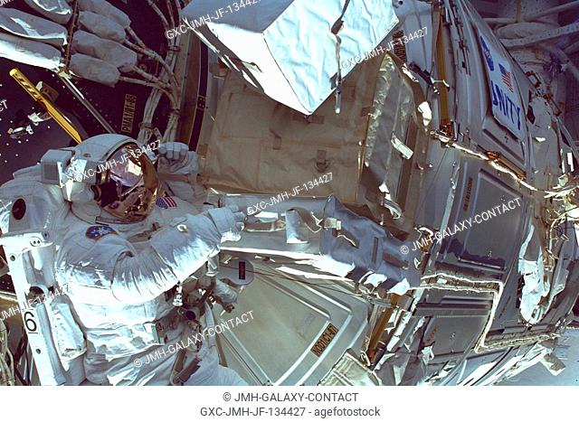 The U.S.-built Unity node occupies the attention of astronaut Daniel T. Barry as he participates in the May 30 space walk during which he and astronaut Tamara E