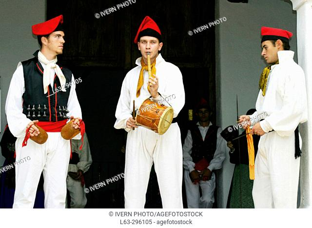 Traditional outfits and musical instruments ('castañuelas', 'timbal', 'flautí' and 'sable'). Sant Miquel de Balansat. Ibiza. Balearic Islands. Spain