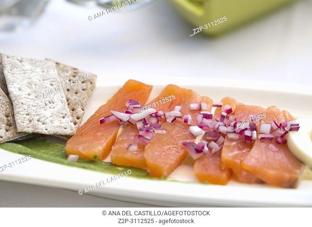 marinated salmon for starter on table