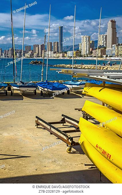 Vertical view of a yellow canoes in Benidorm port, Alicante north, Spain