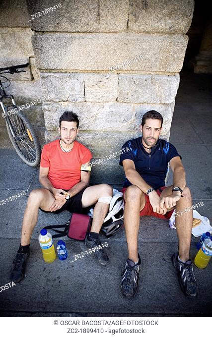 Two Pilgrims in Obradoiro Square in Santiago de Compostela
