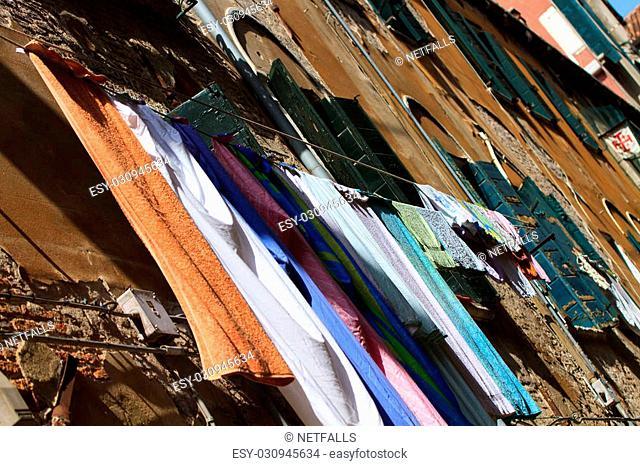 Narrow street in Venice Italy with drying laundry