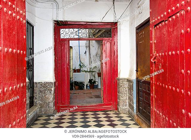 Red door of a house, historic center, Marbella. Malaga province Costa del Sol. Andalusia Southern Spain, Europe