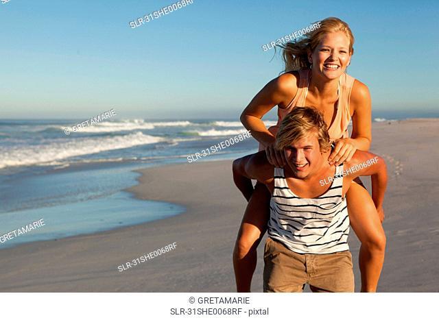 Boy carrying Girl