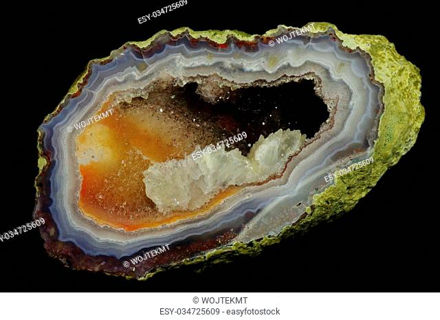 A cross section of agate stone with geode on a black background. Origin: Morocco, Asni. Andrzej Kuzma collection