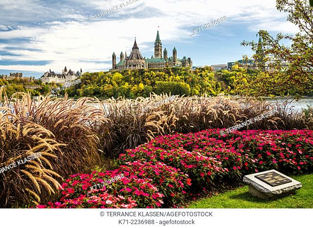 Parliament Hill with fall foliage color and the Ottawa River from Hull, Quebec, Canada