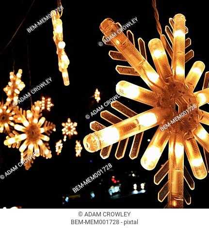 Close up of illuminated snowflake lights