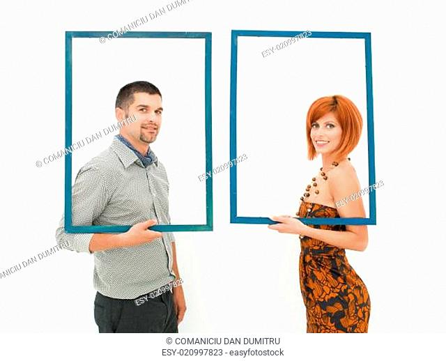 woman and man looking through empty frames