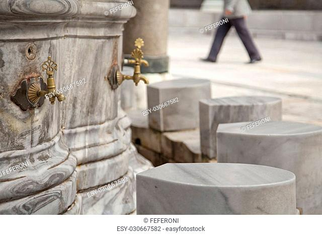 Ablution taps where worshippers wash their feet before prayer time. Beayazit mosque, Istanbul, Turkey