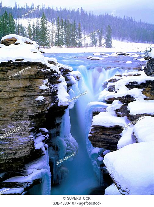 Winter View of the Athabasca River Spilling Over Athabasca Falls, Jasper National Park, Alberta, Canada