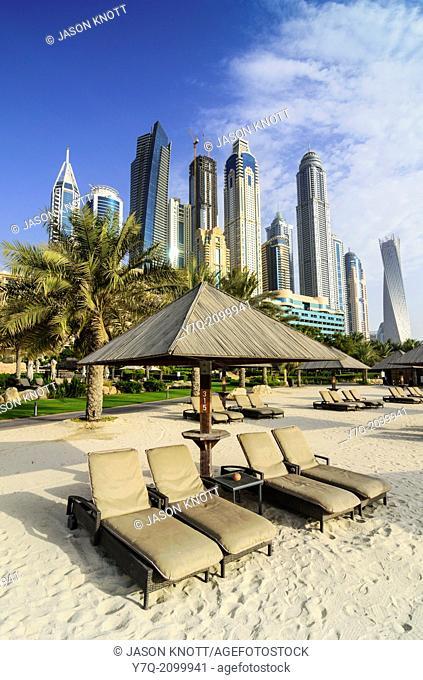 Skyscrapers of Dubai Marina tower above The Westin Dubai Mina Seyahi Beach Resort Hotel, Dubai, UAE