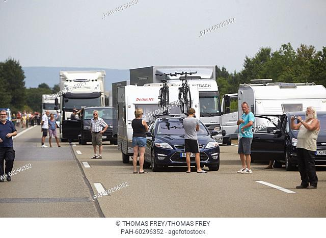 Cars and motorbikes stuck in a jam following an accident involving a truck on teh Autobahn A61 motorway near Kruft, Germany, 24 July 2015